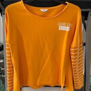 Orange and white sweatshirt